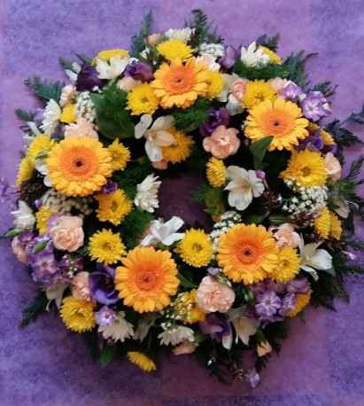 yellow, white and blue wreath